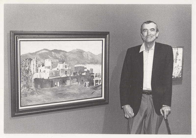 Artist standing next to his painting.