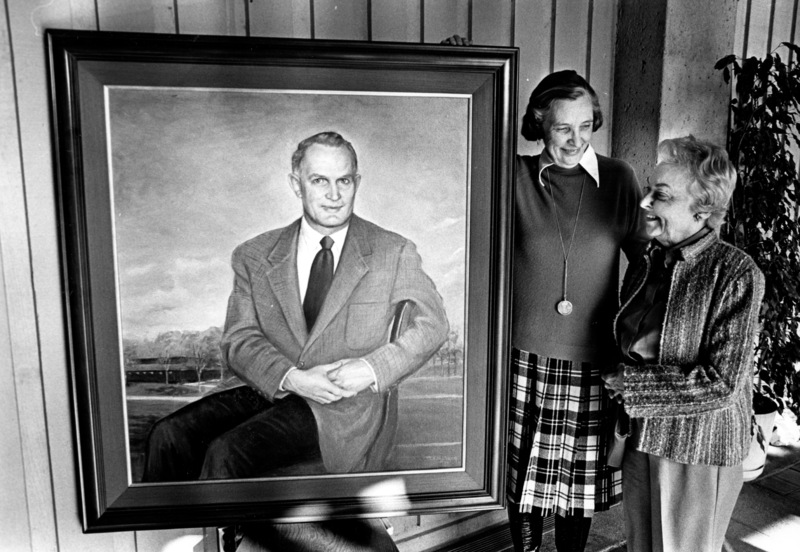 Calvin Flint's widow, Lenore Flint Maxwell (left) and Mary Ann Walburn view the oil portrait of Dr. Calvin C. Flint before it is mounted on a hallway wall inside the Flint Center for the Performing Arts in 1982.
