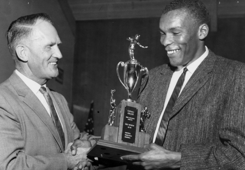 Dr. Calvin C. Flint presents the Most Valuable Athlete of 1960-1961 award to Mike Nichols, who excelled in football, basketball and baseball for Foothill College. Photo taken in 1961 at the temporary college location in Mountain View.