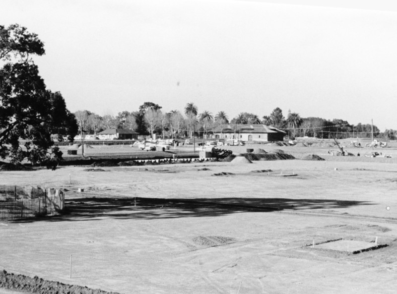 By 1966, the land had been cleared and construction of the college had begun. Near the center of the photo can be seen the winery building, which would later be home to the De Anza College Bookstore. It is now Financial Aid, Printing Services and adjunct faculty offices.