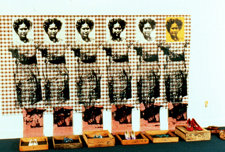 Installation with six identical images of a woman in a house dress, six different pairs of shoes.