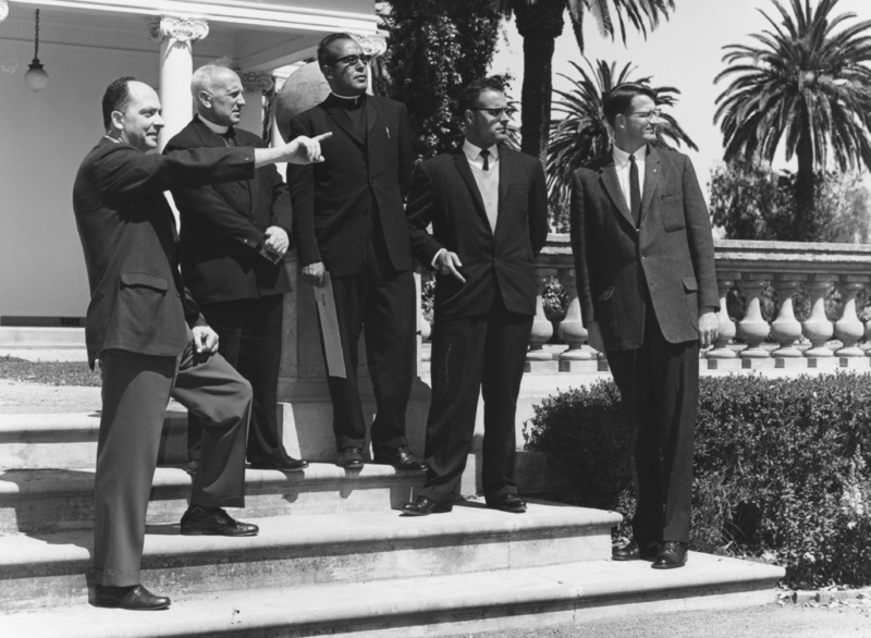 A group of visitors stands on the steps of Le Petit Trianon in 1965. This buidling is now the California History Center.