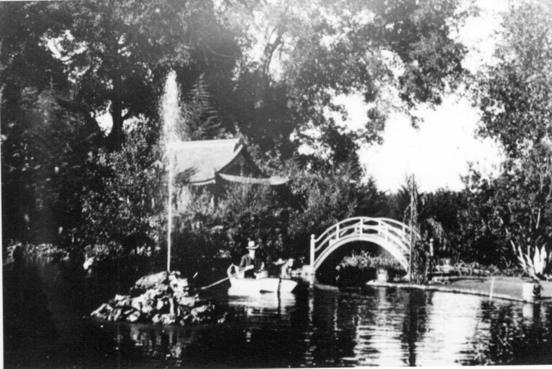 Willard M. Griffin takes his dog for a ride in his rowboat on the fish pond that surrounds an island upon which the tea house sits. Note the gushing water feature in the pond, not seen in other photos. Date of photo unknown, but estimated to be between 1906 and 1913.