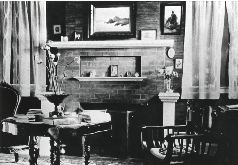 The living room of the Griffin House featured a large brick fireplace, which was the primary source of heat. Photo taken in 1908.