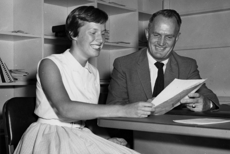 Sherill Ann Houseman, who plans to enroll at Foothill College, talks with Dr. Calvin C. Flint about her plans as a psychology major. Photo taken in 1958 at Foothill College's temporary location in Mountain View.