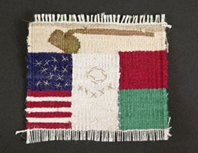 Small weaving. A brown hoe at the top, partial flags of the U.S. and Mexico below.