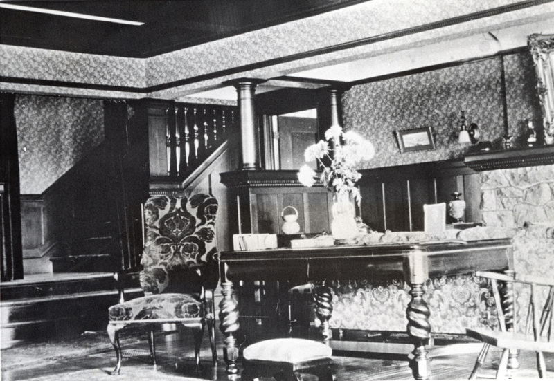 The living room of the Griffin House in 1908 shows the extensive use of California wood used for trim, paneling and staircase construction.