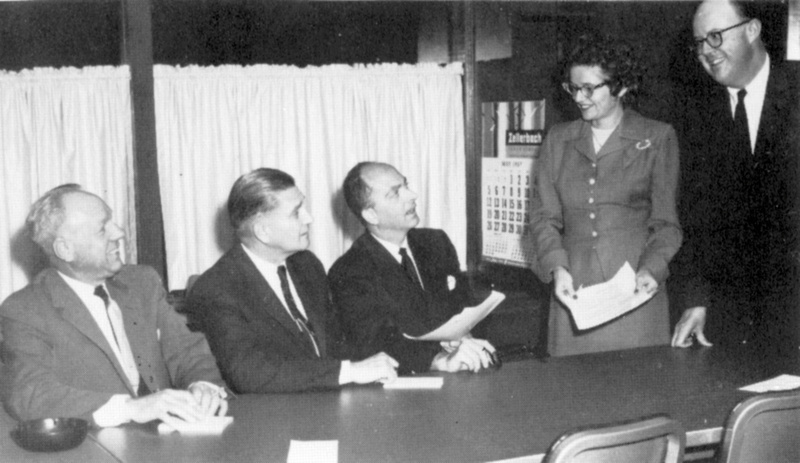 The first Board of Trustees meets at the storefront offices located at 176 Second Street in downtown Los Altos. Seated left to right: A. P. Christiansen, Dr. Howard G. Diesner, Dr. Robert C. Smithwick (Chairman,)  Mrs. Mary Levine, Robert F. Peckham.