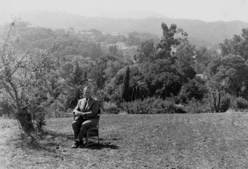 Calvin Flint sits in a classroom desk on the site of the future Foothill College. This photo was taken in 1958, just after the purchase of 122 acres of land in Los Altos Hills was completed.