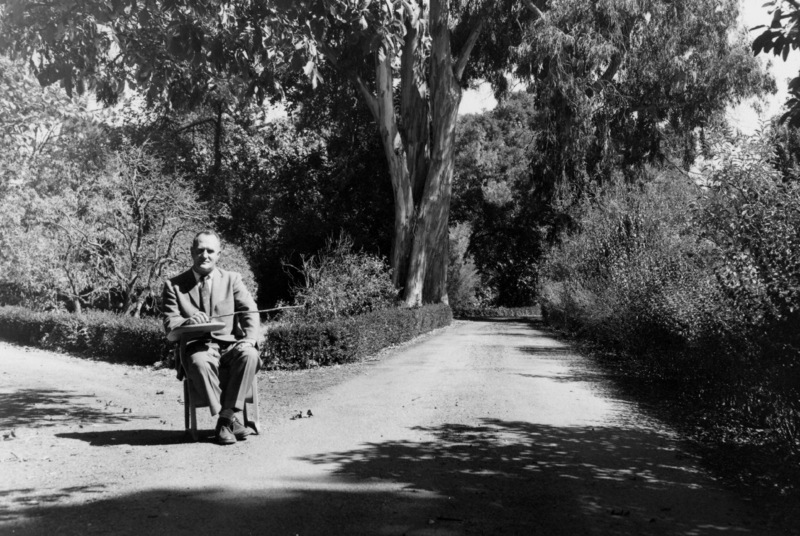 A second view of Calvin Flint  in a classroom desk on the site of the future Foothill College. This photo was taken in 1958, just after the purchase of 122 acres of land in Los Altos Hills was completed for approximately $900,000. The purchase was funded by a local bond.