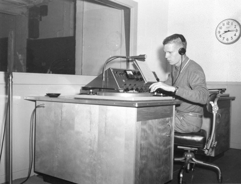 Bob Ballou, station manager, sits at the radio control panel in the basement of Foothill College in Mountain View. Photo from September 11, 1959 edition of Foothill Sentinel.