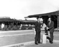 Dr. Calvin C. Flint (left) and Dr. Robert Smithwick (right) talk about the newly completed Foothill campus in Los Altos Hills in 1962. Picture taken in front of the Foothill Theater, now called the Smithwick Theater