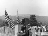 At the Foothill College ground breaking ceremony on June 30, 1960, Dr. Calvin C. Flint unveils a plaque commemorating the event. This plaque can still be viewed on the campus - it is affixed to the base of the flagpole near the Foothill Administration building. The campus opened to the public in September of 1961, just fifteen months after this ground breaking ceremony.