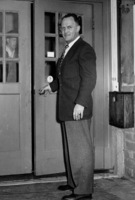 Calvin Flint stands at the rear entrance to the first meeting space for the Board of Trustees, located in a small building in downtown Los Altos. The Board continued to meet in this space from 1958 until 1961, when the new Foothill campus opened in Los Altos Hills.