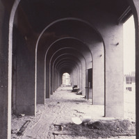 A view through some of the archways that have become iconic for De Anza College. These arches surround the swimming pool. This image was captured in 1966; the college opened in September of 1967.