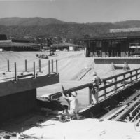 The Footbridge, Campus Center, Campus Loop Road and Appreciation Hall under construction.  The Los Altos Hills campus opened to the public in the Fall of 1961.